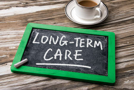 care at home: long-term care handwritten on blackboard