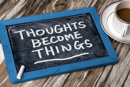 thoughts become things handwritten on blackboard Stockfoto