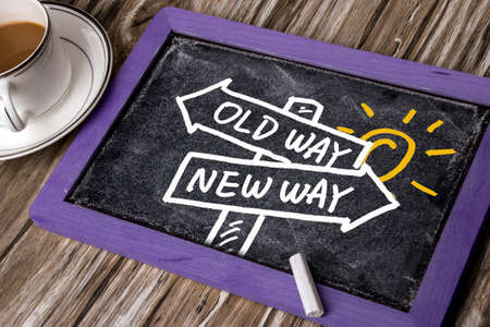 new way: choose new way concept hand drawing on blackboard background