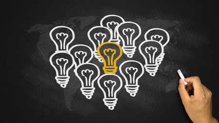 outstanding: light bulbs outstanding idea concept hand drawing on blackboard Stock Photo