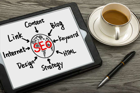 back link: seo concept flowchart hand drawing on tablet pc