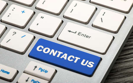 technology market: contact us concept on keyboard Stock Photo