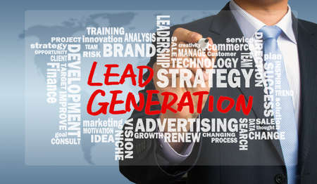 lead generation concept handwritten by businessman with related words cloud Standard-Bild