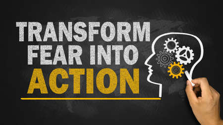 fear: transform fear into action concept on blackboard