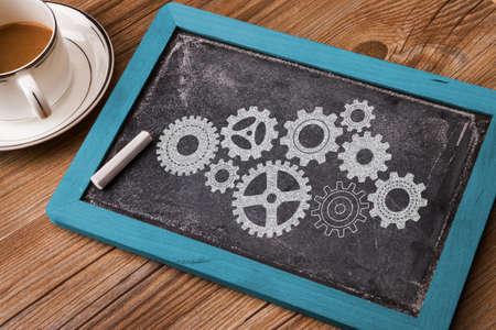 cognicion: business concept: gears hand drawn on chalkboard Foto de archivo