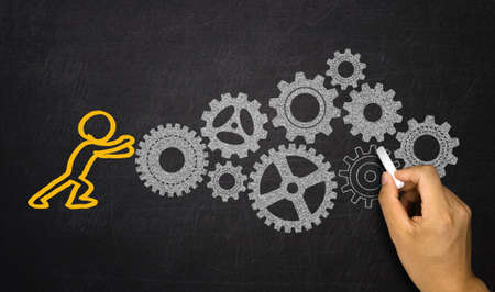 business gears: business concept:people activating gears mechanism