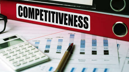 competitiveness concept on document folder Stock Photo