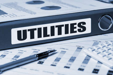 utility payments: utilities concept on document folder Stock Photo