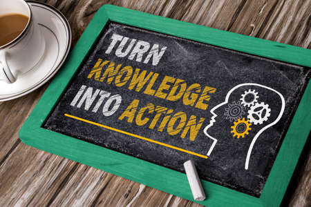 action: turn knowledge into action concept on blackboard Stock Photo
