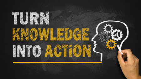 turn knowledge into action concept on blackboard Standard-Bild