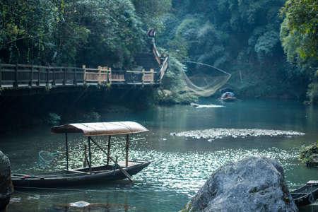yangtze: ancient fishing boat on yangtze river