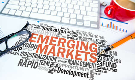 emerging markets: emerging markets word cloud on office scene Stock Photo