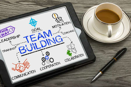 team communication: team building concept drawn on tablet pc