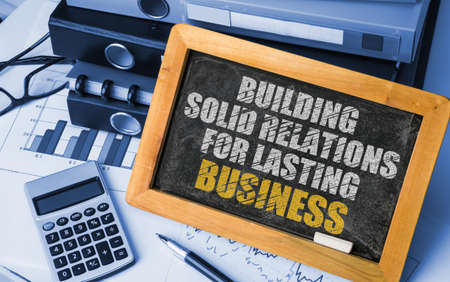 lasting: Building Solid Relations For Lasting success drawn on blackboard Stock Photo