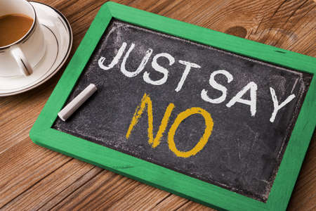 say: just say no written on small blackboard Stock Photo