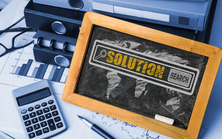 business solutions: search for solution concept on blackboard Stock Photo