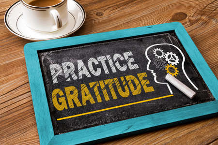 practice gratitude concept on chalkboard