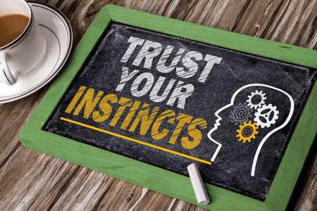 instincts: trust your instincts concept on chalkboard
