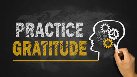 gratitude: practice gratitude concept on chalkboard