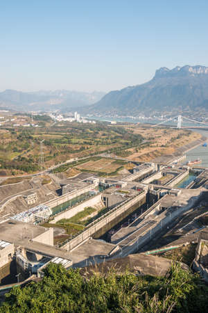 lift: the Three Gorges Dam area at Yangtze River on a foggy day