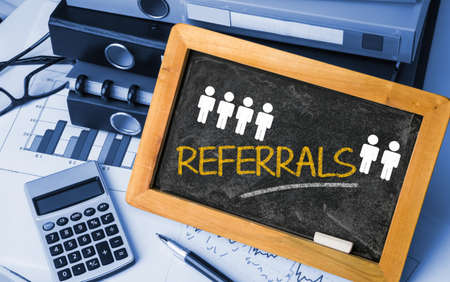 referrals: referrals concept handwritten on blackboard