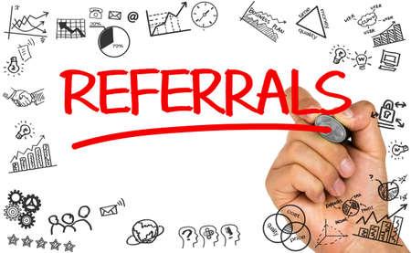 referrals: referrals concept handwritten on whiteboard Stock Photo