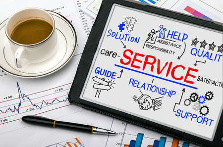 business service: service concept with business elements drawn on tablet pc Stock Photo