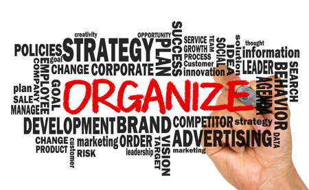 organize: organize with related business word cloud handwritten on whiteboard Stock Photo