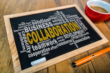 common vision: collaboration word cloud on small blackboard Stock Photo