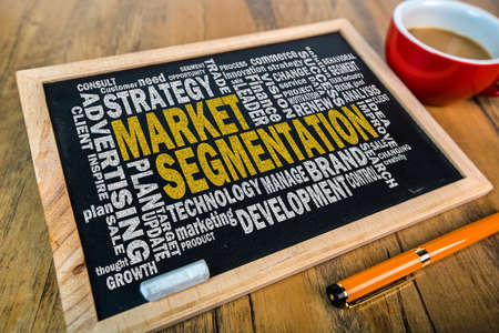 segmentation: market segmentation word cloud on small blackboard