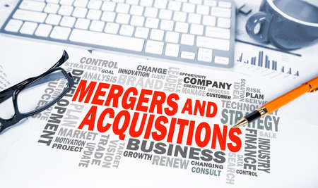 mergers: mergers and acquisitions word cloud on office scene