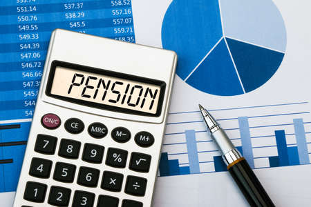 pension: pension concept displayed on calculator Stock Photo