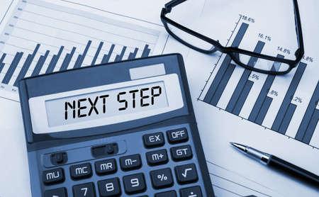 next step displayed on calculator Stock Photo