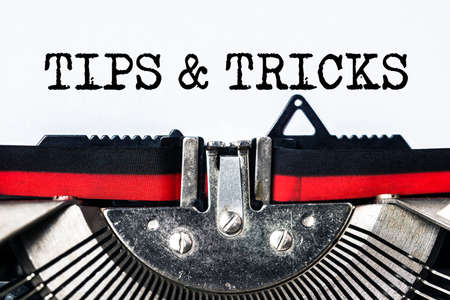 tips and tricks typed on white paper with old typewriter
