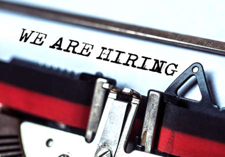 we are hiring typed on white paper with old typewriter