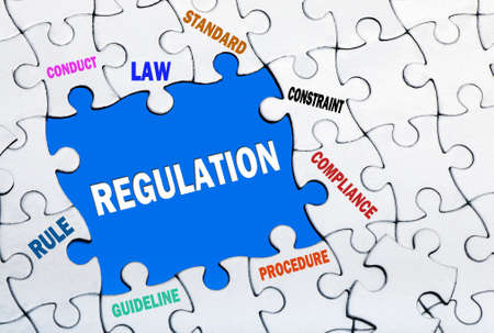 regulation: REGULATION Concept with puzzles Stock Photo