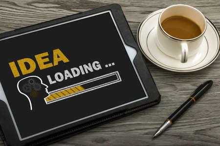 idea loading concept on touch screen Standard-Bild