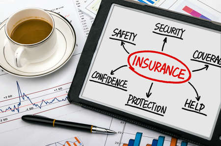 insurance concept flowchart hand drawing on tablet pc Standard-Bild