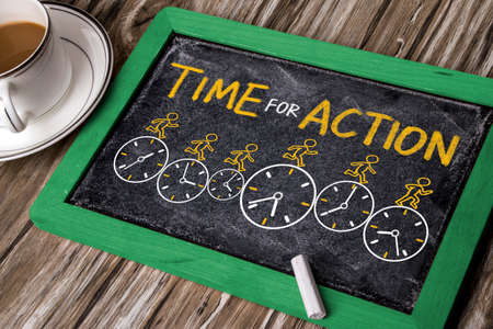 time for action concept on blackboard