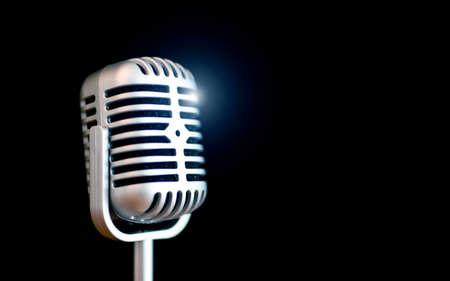 retro microphone on black background