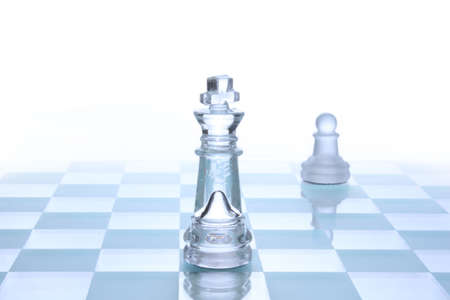 chess move: Translucent glass chess figures on a board Stock Photo