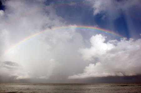 Colorful rainbow over ocean after storm