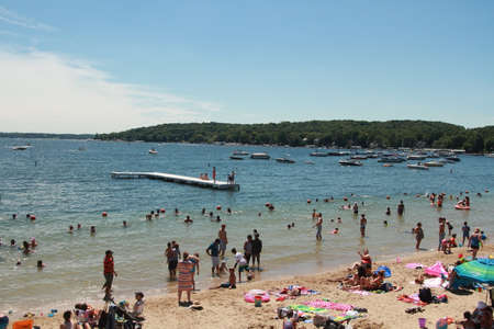 Lake Geneva, WI - July 03: Lake Geneva on July 03, 2016 in Wisconsin. People rest on the beach lake geneva in Wisconsin, USA.