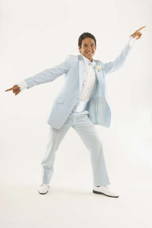 Young man dancing in tuxedo LANG_EVOIMAGES
