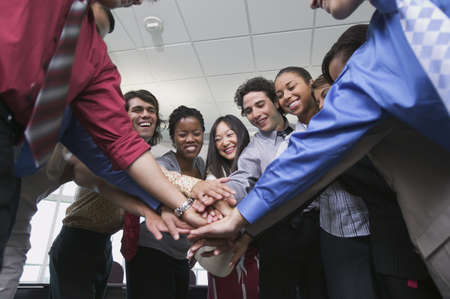 Low angle view of business executives in a huddle