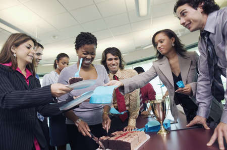 Low angle view of business executives in an office party LANG_EVOIMAGES