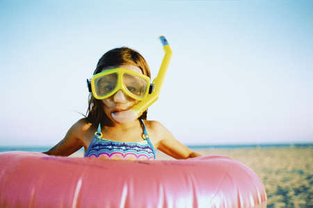 Girl wearing snorkeling apparatus at the beach