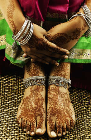 Close-up of decorated feet of a young woman