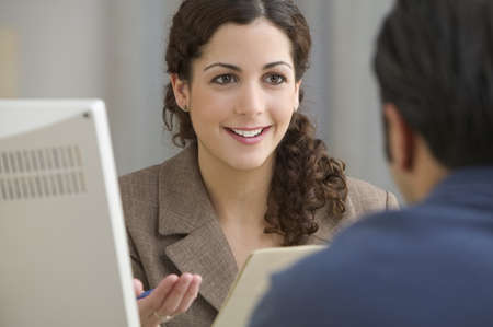 Businesswoman interviewing prospective employee LANG_EVOIMAGES