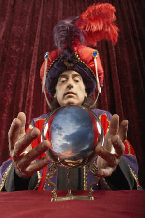 Magician with crystal ball LANG_EVOIMAGES